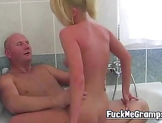Blond girl fucks hard in bathroom