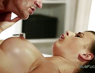 sexy brunette is getting her large breasts massaged into a green vise