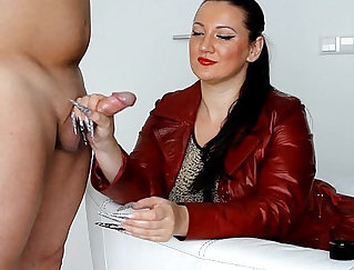 Ana Lyn doing an Handjob on the leather couch