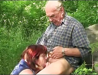 Attractive tramp granny fucked outdoors