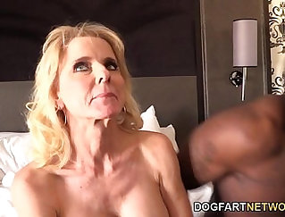Black cougar teases her wet pussy